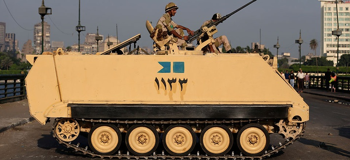 An Egyptian army soldier guards an entrance to Tahrir Square