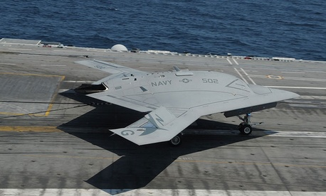 An X-47B lands on the deck of the USS George H.W. Bush after a test flight