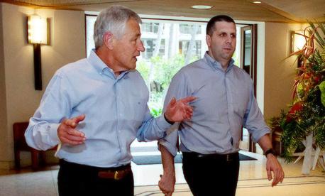 Defense Secretary Hagel walking with his chief of staff Mark Lippert