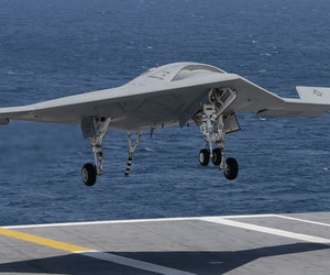An X-47B landing on the deck of the USS George H.W. Bush