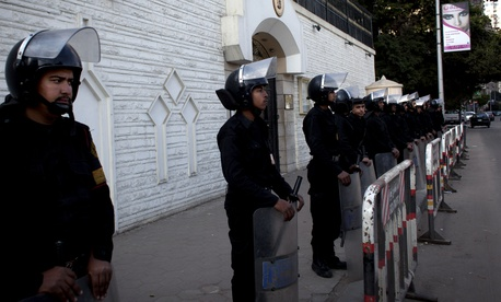 Egyptian riot police stand guard at the UAE embassy during a Muslim Brotherhood protest.