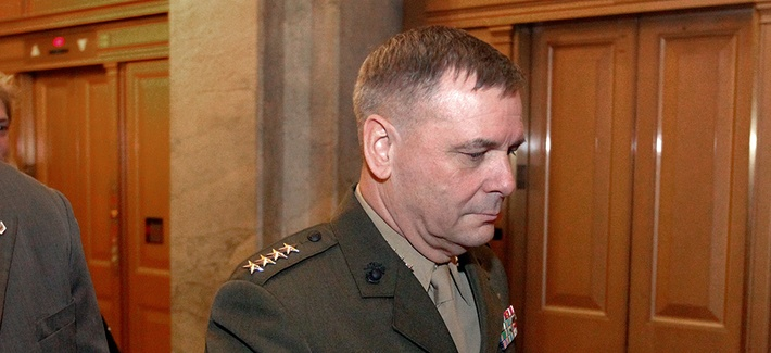 Gen. James Cartwright walks out after speaking on Capitol Hill