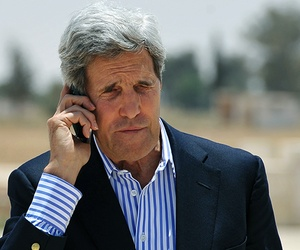 Secretary of State John Kerry speaking on the phone in Jordan