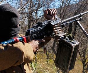 A Pakistani Taliban militant firing a machine gun in Waziristan