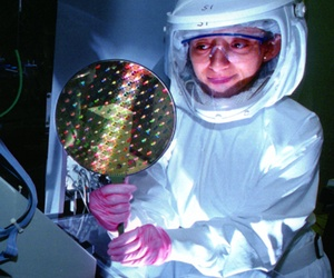 A scientist holding a radiation hardened computer chip