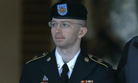 Army Pfc. Bradley Manning being escorted outside a courthouse at Fort Meade, Md.
