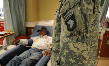 "Capt. Trey Vaughn, chaplain in the 563rd Air Support Battalion, 159th Combat Aviation Brigade, visits with Johnny ""Lawman"" Wordlaw, a Vietnam veteran at the VA Hospital in Nashville, Tn., November 2012."