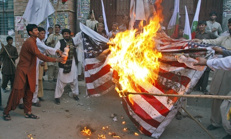 Protestors from a religious party burn a U.S. flag during an anti-NATO protest in July 2012