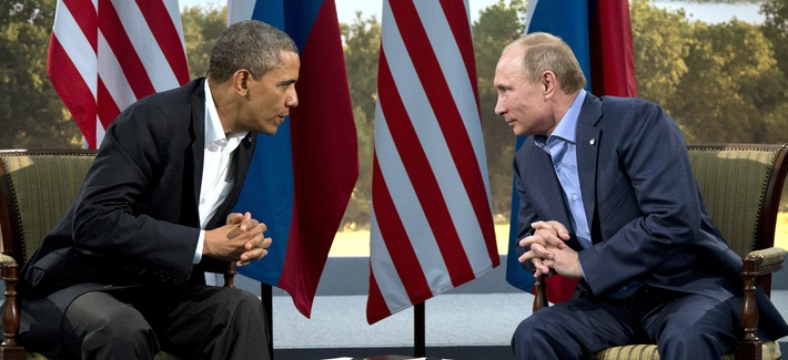 President Obama and Russia's President Vladimir Putin speaking to each other at the G-8 Summit in Northern Ireland