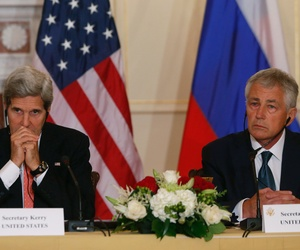 Secretary of State John Kerry and Defense Secretary Chuck Hagel attend a meeting witt their Russian counterparts at the State Department on Friday.