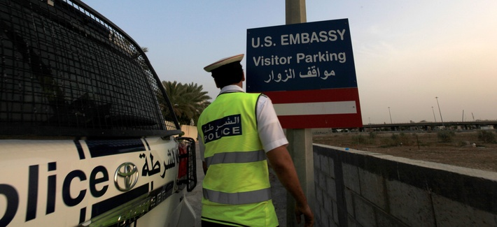 A policeman in Baharain patrols a checkpoint at a road leading to U.S. Embassy Manama