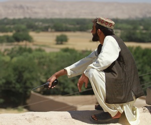 An Afghan Local Police commander conducts watch in Sangin earlier this year.