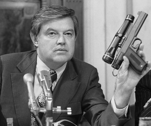 Sen. Frank Church D-Idaho, holding a CIA dart gun at a committee hearing