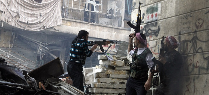 Fighters with the Free Syrian Army fire at government forces in Aleppo, Syria