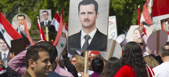 Syrians rally in support of the Assad regime at The Hague in Holland last year.