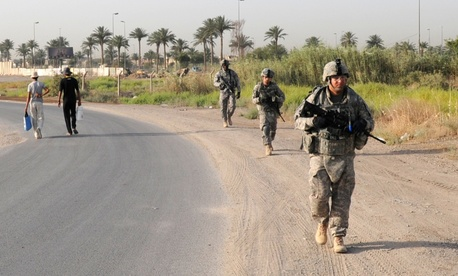 Troops with the 1st Battalion, 7th Field Artillery Regiment patrol in Iraq in 2011.