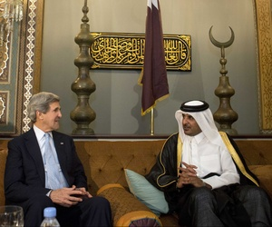 Qatar's leader Sheik Tamim bin Hamad Al Thani speaking with Secretary of State John Kerry