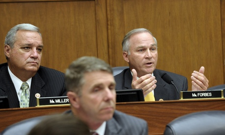 Members of the House Armed Services Committee speak during a committee hearing on a proposed AUMF