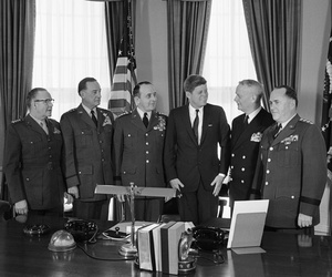 President John F. Kennedy standing with members of the Joint Chiefs of Staff