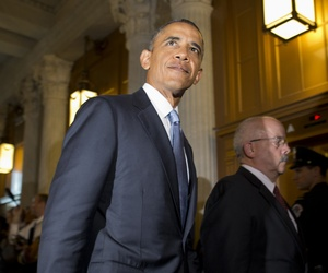 President Obama walking to a meeting with Democratic senators on Capitol Hill