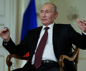 Russian President Vladimir Putin speaking to a reporter during an interview in Moscow