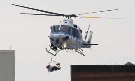 A U.S. Park Police helicopter airlifts a worker at the Washington Navy Yard