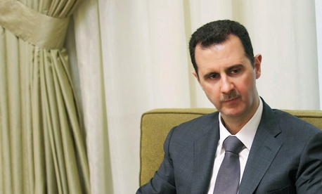 Syria's President Bashar Al-Assad speaking during an interview in July
