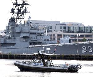 A police boat patrols the water near Washington Navy Yard