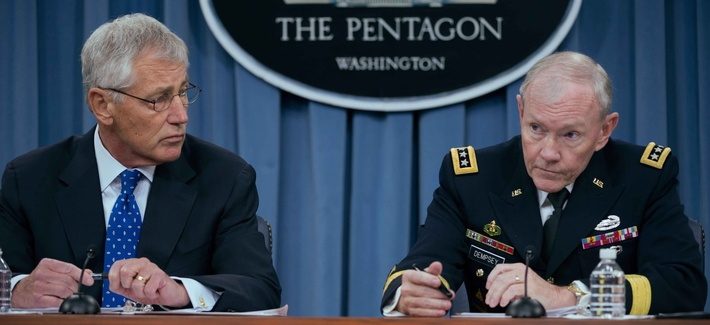 Secretary of Defense Chuck Hagel and Chairman of the Joint Chiefs of Staff Martin Dempsey during a briefing at the Pentagon