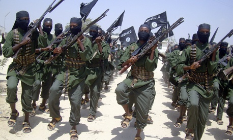 Al-Shabab fighters march during military exercises outside Mogadishu, Somalia, in 2011.