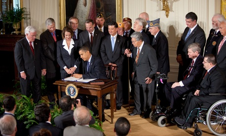 President Obama and congressional leaders signing the Veterans Health Care Budget Reform and Transparency Act