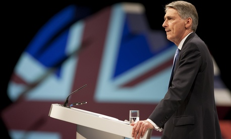 Britain's Defense Secretary Philip Hammond speaking at a Conservative Party Conference in Manchester, England
