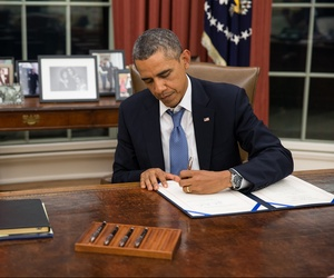President Obama signs the Pay Our Military Act on Oct. 1.