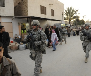 U.S. soldiers patrol a market in Baghdad in 2009.