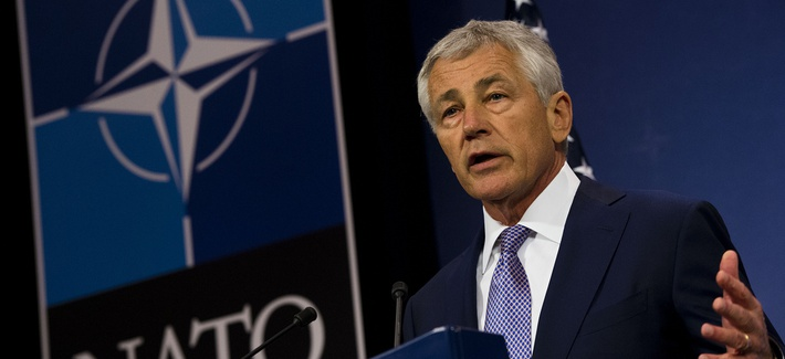 Defense Secretary Chuck Hagel briefs the press at a NATO meeting in Brussels in June.