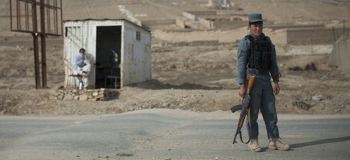An Afghan policeman mans a checkpoint  in Wardak province.