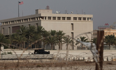A Bahraini security vehicle guards the U.S. Embassy in Manama, Bahrain
