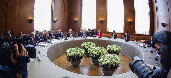 The negotiators for the P5+1 talks sitting at a roundtable in Geneva, Switzerland