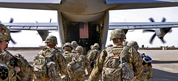 Soldiers board an Air Force C-130 bound for Joint Base Lewis-McChord