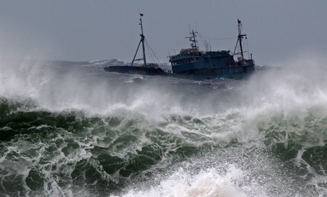 A boat is thrashed by waves near Jeju Island, which is near Sokora Island