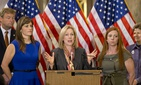 Sen. Kirsten Gillibrand, D-N.Y., standing alongside sexual assault victims during a news conference on Capitol Hill