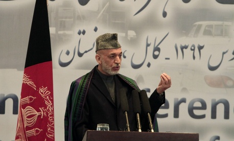 Afghanistan's President Hamid Karzai speaking at a conference in Kabul, Afghanistan