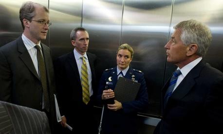 Principal deputy undersecretary of defense for intelligence Marcel Lettre with Secretary of Defense Chuck Hagel and former Pentagon Press Secretary George Little