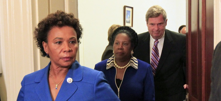 Rep. Barbara Lee, D-Calif., walks out of a meeting with Rep. Sheila Jackson, D-Texas, on Capitol Hill