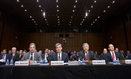 NSA Deputy Director Chris Inglis (center), testifies at a congressional hearing on intelligence