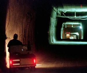 A worker drives a cart through a tunnel inside the Waste Isolation Pilot Plant 2,150 feet below the surface near Carlsbad, N.M.