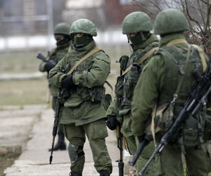 Unidentified gunmen guard Ukraine's infantry base in Privolnoye, Ukraine, on Sunday.