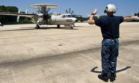 An E-2D Hawkeye with the Pioneers of Air Test and Evaluation Squadron preparing for takeoff