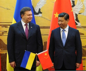 China's president Xi Jinping during a meeting with Ukraine's former President, Viktor Yanukovich