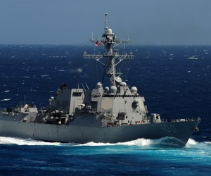 The USS Kidd, pictured above, is joining in the search efforts for the missing Malaysian Airlines flight